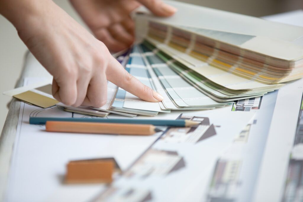 Young designer working with color palette
